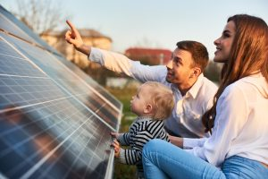 Man,Shows,His,Family,The,Solar,Panels,On,The,Plot