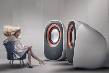 Young,Fashionable,Lady,Listening,To,Big,Loudspeakers