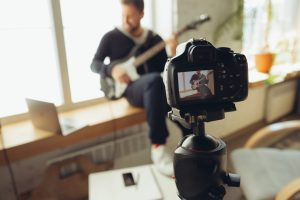 Caucasian,Musician,Playing,Guitar,During,Online,Concert,At,Home,Isolated