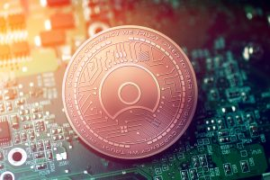 Shiny,Copper,Simple,Token,Cryptocurrency,Coin,On,Blurry,Motherboard,Background